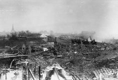 German cavalry riding through a ruined town/May 1917