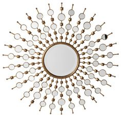 Z Gallerie's outstanding Solstice mirror decorates a wall with a burst of brilliant Silver mirror and Gold leaf. Rays of burnished Gold leafed metal emanate