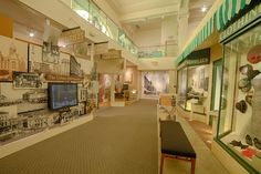 """The Joliet Streetscape depicts store fronts, merchandise, and a streetcar from the early part of the 20th century. Museum visitors can """"ride"""" the Joliet Interurban Trolley and view what the city looked like in the early 1900's!"""