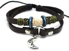 Beaded Two Strand Leather Bracelet with a Metal Moon Charm, Metal Studs, Colorful Blue Wooden Beads, Bronze Colored Metal Spacers, and White and Dark Green Hemp Wrap on Dark Brown Leather. Adjustable for Men, Women and Teens. (Foil Gift Box Included) . $18.95. Embellished with a Metal Moon Charm,  Metal Studs, Colorful Blue Wooden Beads, Bronze Colored Metal Spacers, and White and Dark Green Hemp Wrap on Dark Brown Leather.. Beaded Two Strand Leather Bracelet with a ...