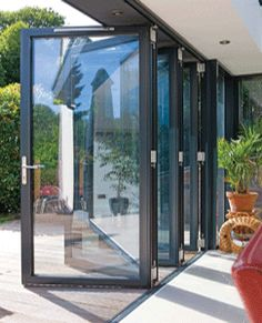 Folding patio doors by heather merenda building blocks pinterest bi folding doors onto level decking in garden so u could see your children playing in the garden planetlyrics Images