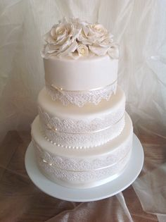 Wedding Cake with Edible Lace and Sugar Roses. www.designer-cakes.co.uk