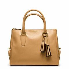 Coach Legacy Top Zip Satchel with tassel. Nice substitute and fraction of the cost of Prada.