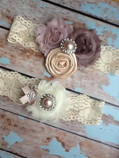 wedding  garter  / bridal  garter / champagne blush  taupe /  lace garter /brown and pink with something blue stone. $37.99, via Etsy.