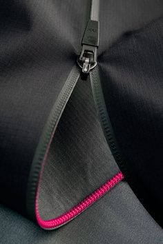 No-tape zipper: Chain looks to be welded directly onto garment fabric