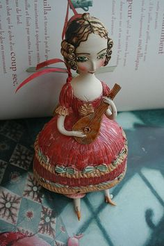 Girl in red playing mandolin Ceramic bell sculpture by yalonetski, $89.00