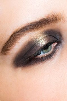 #refinery29 Used Tom Ford's Eyeshadow Quad in Cognac Sable to create this artful, punk-rock eye. She went all the way around the eye with the darkest shade, leaving the center of the eyelid bare for gold eyeshadow. Gold liner for bottom lashline.
