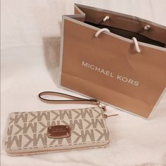 "MSRP: $168 MK wallet slots wristlets New with tags.                                                                                        Size: 8""x4"" Michael Kors Bags Wallets"