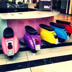 Vespa scooters instead of chairs / seats / bar stools at a counter