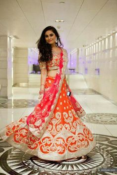 www.weddingstoryz.com Bright orange lehnga with red dupatta and gold detailing