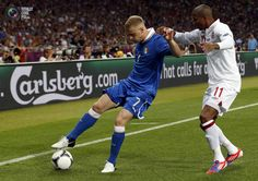 Italy's Abate challenges England's Young during their Euro 2012 quarter-final soccer match at the Olympic Stadium in Kiev. EDDIE KEOGH/REUTERS