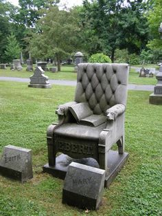 The Ebert chair grave in Lowell Cemetery, MA was reportedly carved from a single piece of granite. The chair is a replica of one owned by the deceased, Mr. Horace Ebert, which consisted of tufted leather and carved dog heads.