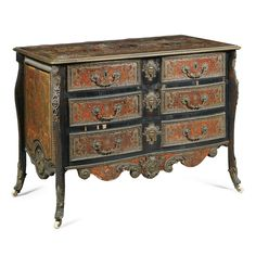 An ebony, red tortoiseshell and brass inlaid boulle marquetry commode part Régence, first quarter 18th century with applied gilt-bronze mounts, inlaid throughout in the manner of Jean Bérain, with two short and two long drawers,