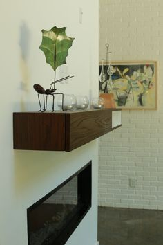 Wood mantel unattached to the fireplace. Electric fireplace