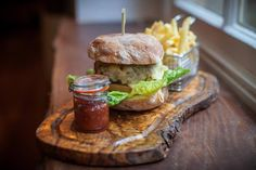 The Racks Burger  100% organic beef burger with smoked Applewood cheese, served on a rusticciabatta with fries and a tomato & shallot relish