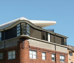 Luigi Rosselli Architects | The Bow Window Penthouse | curved metal roofing on Captain's deck balcony | © Edward Birch