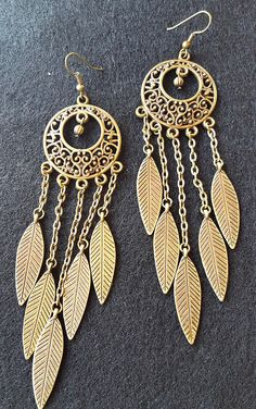 Antiqued Gold Feather Dangle Earrings by 3rdDensityCreations on Etsy