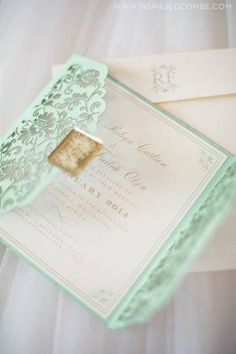 this breathtaking laser cut mint green wedding invitation takes our breath away