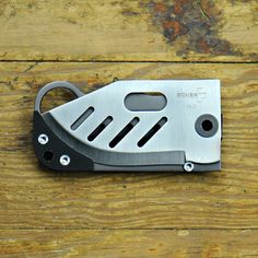 """Very cool titanium wallet knife. Could be the first thing on the new site """"man-terest"""""""