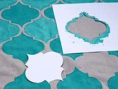 DIY+Network+has+instuctions+on+how+to+make+an+outdoor+rug+from+a+painter's+drop+cloth,+paint+and+stencils.+