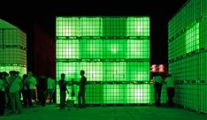 German architects Modulorbeat have created Kubik, a temporary open-air nightclub comprised of 160 large water tanks that light up in tune with the beat. With special wiring, each tank can be individually controlled and glow in any color.