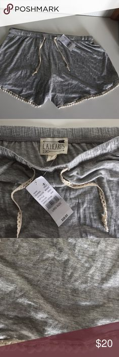 **NWT grey shorts with cute detailing!** Grey shorts with cute embroidery! ** not brandy Melville but I have many brandy listings in my closet if interested ! ** Brandy Melville Shorts