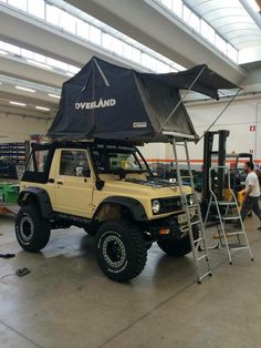 Suzuki Samurai with rooftop tent