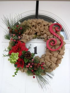 This is a beautiful Christmas wreath. It has the reds and greens we all love with Christmas. It is wrapped in a fabulous tan burlap which adds