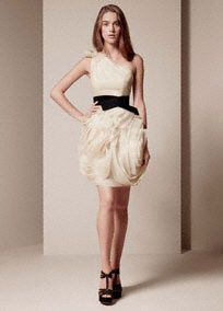 One-shoulder organza dress with hand-cut bias-flange skirt and elastic black belt.   Elegant, one shoulder gown with bias-cut flange skirt, and a waist-slimming elastic belt.  Raw-edged shoulder tie and flange skirt are signature Vera Wang details.  This is the kind of dress that inspires special occasions and celebrations, so we are also offering it in Ivory, making it an ideal reception dress for the bride.  Invisible side zip. Fully lined. Dry clean only.  Available in select stores in Charc…