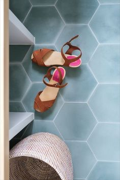clé offers over 50 colors of hexagon cement tiles. shown here, our basil teal color as the floor tiles of this mudroom. our cement hexagon tiles are stylish and durable; perfect to create hex tile blends that suit your own design and home decor style. #floors #cement #tiles #mudroom #design #homedecor