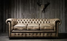 I'm not quite sure how to reconcile my love for Chesterfield sofas and sleek mid-century modern sofas. Conflicting favorites, I guess.