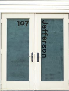 For added privacy on a glass door try frosted glass, and keep it moderns with you address numbers in the glass!