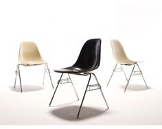 A set of six (6) molded fibreglass stacking/dining chairs by Charles and Ray Eames for Herman Miller; four (4) parchment coloured, two charcoal/black, circa late 1950s