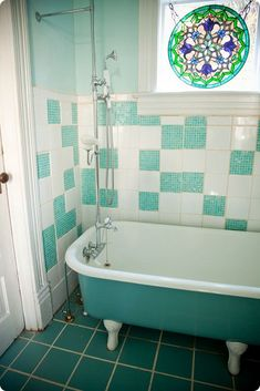 turquoise - mix old and new to still look vintage, combined small tile with regular tile, painted outside of tub to match floor.