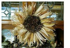 Sunflower from cornhusks and pinecones