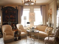 Slatkin NYC home:  The canapé is covered in 18th century horsehair from Drouot in Paris; the tub chairs in a hand-painted fabric, and the French chair is upholstered in needlework in a branch design inspired by a Matisse drawing belonging to Howard.