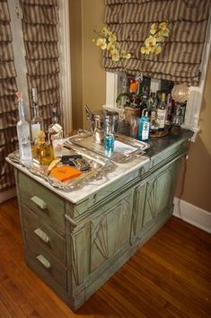 The Find: The table holds drink, mixers, glassware and party accoutrements for entertaining. Stylish Bars, Decorating Tips, Bakers Table, New Orleans Homes, Home Kitchens, Home, Wood Pieces, Home Decor, Elements Of Design