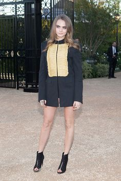Cara Delevingne in Burberry. [Photo by Katie Jones]