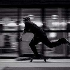 This picture shows movement because the boy who is on his skateboard is going so fast that the background is blurry.