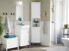 Home: Dream Bathrooms A country bathroom in white and gray, with SILVERÅN sink cabinet and corner…