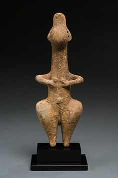 """Amiash Idol,  Ancient Near East.  1st millennium B.C.E.  Terracotta.  Amlash refers to sites in the province of Gilan, Iran, along the Caspian Sea. Figures and animals were made in ceramic and bronze. The figures with """"button"""" faces are thought to have been used in conjunction with burial rituals."""