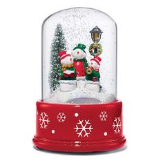 """AVON EXCLUSIVE Add something cool to your home with this magical snow-blowing scene. On/off switch with multiple options to feature snow-blowing effect and lights alone, or with music. Uses 3 AAA batteries (not included). 7 1/2"""" H x 5 3/4"""" diam. Glass, plastic. Imported.While Supllies Last"""