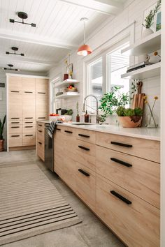 A Drab Galley Kitchen Gets A Modern Transformation At The Midwest Malibu Cottage – Front + Main – Home Renovation Ikea Galley Kitchen, White Galley Kitchens, Galley Kitchen Design, Galley Kitchen Remodel, New Kitchen, Home Kitchens, Kitchen Remodeling, Kitchen Counters, Kitchen Islands