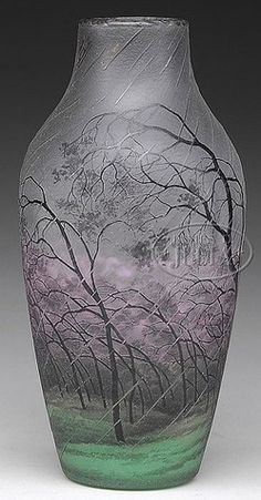 A Daum Nancy Cameo vase having a rain scene depicted with swaying trees in dark earthen hues against a vibrant pink, green and frost ground. The rain is depicted in clear glass against this background coloration. Signed, made in France, circa 1875-1910