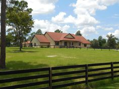 Horse Property for Sale in Citrus County in Florida. Charming equestrian ranch with ten spectacular cleared acres of lush green grass and 4 board fencing in the upscale and much sought after community of Pineridge Farms in Beverly Hills, Florida.