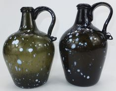 Almost matched pair of 9 inch handled bottles. Note the variation in colour! C1810/20