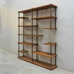 The asymmetrical etagere/bookcase design has multiple levels of large and small shelves perfect in form and function. Sleek and chic this open bookcase shows off your library plants decor items and… Pipe Furniture, Retro Furniture, Colorful Furniture, Home Office Furniture, Cool Furniture, Furniture Design, Furniture Ideas, Bedroom Furniture, Corner Furniture