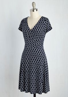 Whether you decide on blueberry oatmeal or waffles at the botanical garden's cafe, you already made a stylish choice by donning this navy dress. Boasting a fancy lattice print, flirty wrap top, and softly gathered details, this breezy frock is as beautiful as the blooms that surround you!