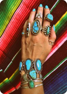 i think the turquoise finger nail polish is a bit much - but the jewelry is gorgeous!
