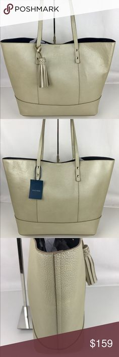 """Cole Haan Bayleen Leather Tote - Soft Gold Authentic. New, with Tags. A few minor marks from handling.  100% Leather. Lining, Magnetic Snap closure. 9"""" Shoulder drop. 16""""L x 12.5""""H x 6""""D. 1 interior zip pocket. Removable zipper bag. Super cute tassel.  Thank you for your interest!   PLEASE - NO TRADES / NO LOW BALL OFFERS / NO OFFERS IN COMMENTS - USE THE OFFER LINK :-) Cole Haan Bags Totes"""